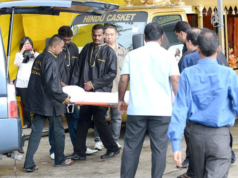 The body of the dead gangrape victim arrives at a funeral parlour for embalment in Singapore. AFP