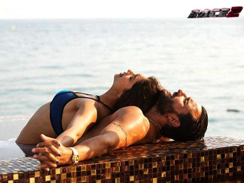 Deepika Padukone and Saif Ali Khan look hot in a still from the movie Race 2.