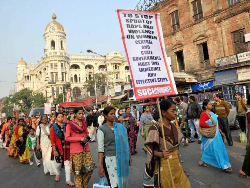 Students carry banners as they take part in a protest rally in Kolkata. AFP Photo