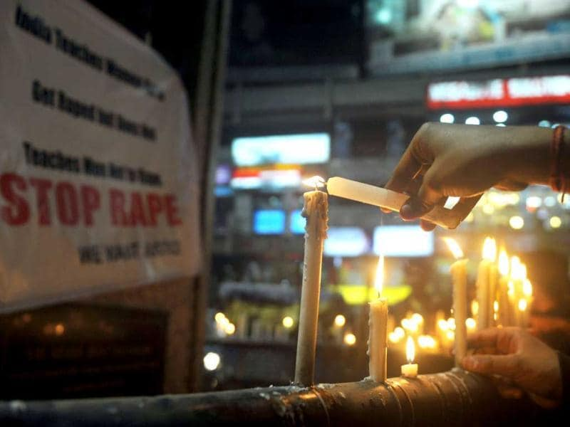 Protesters take part in a candlelight procession in Siliguri. AFP Photo