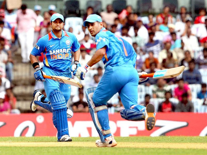 MS Dhoni and Suresh Raina during the 1st ODI match against Pakistan at MAC Stadium in Chennai. PTI/R Senthil Kumar
