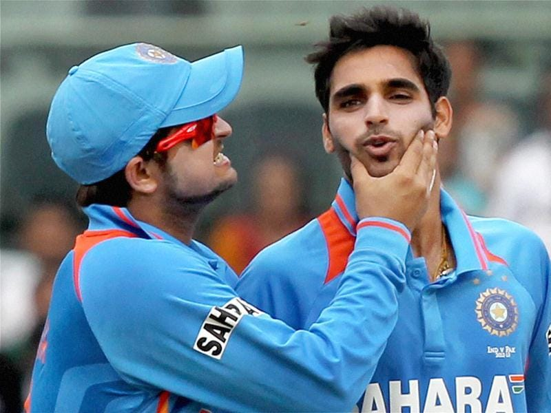Bhuvneshwar Kumar being greeted by his teammate Suresh Raina for taking the wicket of Mohammad Hafeez during their 1st ODI match at MAC Stadium in Chennai. PTI Photo