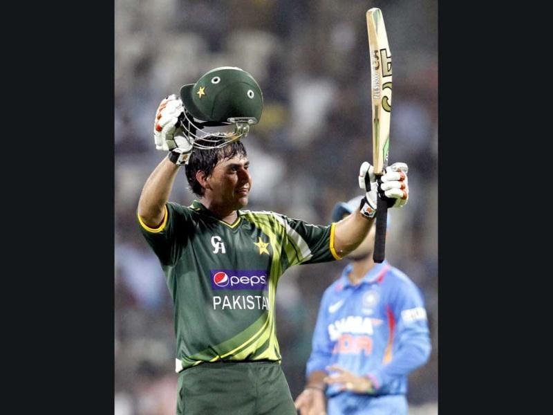 Pakistan's Naser Jamshed raises his bat after scoring a century during the 1st ODI cricket match between India and Pakistan at MA Chidambaram Stadium in Chennai. Mohd Zakir/HT