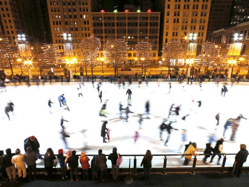 People skate on an ice rink in Chicago. Snow and cold have been lacking in Chicago recently and one of the city's winterless weather streaks has now tied an all-time record. AP/Nam Y Huh
