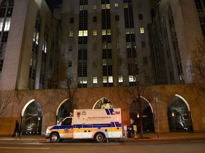 An ambulance stands in front of New York Presbyterian Hospital where US Secretary of State Hillary Clinton is hospitalized in New York. AFP/Emmanuel Dunand