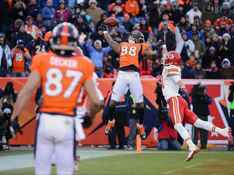Demaryius Thomas #88 of the Denver Broncos catches a touchdown pass against Javier Arenas #21 of the Kansas City Chiefs at Sports Authority Field at Mile High in Denver, Colorado. AFP/Garrett W Ellwood/Getty Images