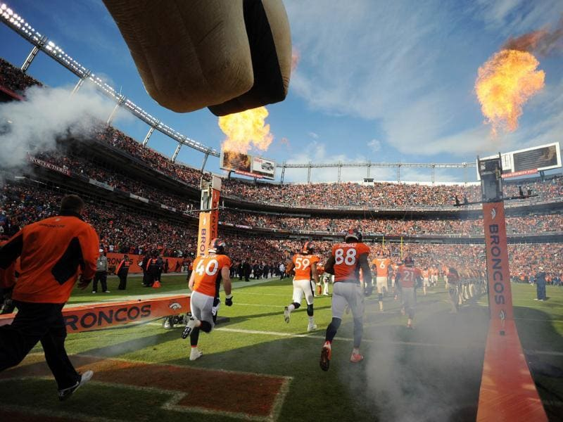 Jacob Hester #40 and Demaryius Thomas #88 of the Denver Broncos run out onto the field prior to the game against the Kansas City Chiefs at Sports Authority Field at Mile High in Denver, Colorado. AFP/Garrett W Ellwood/Getty Images