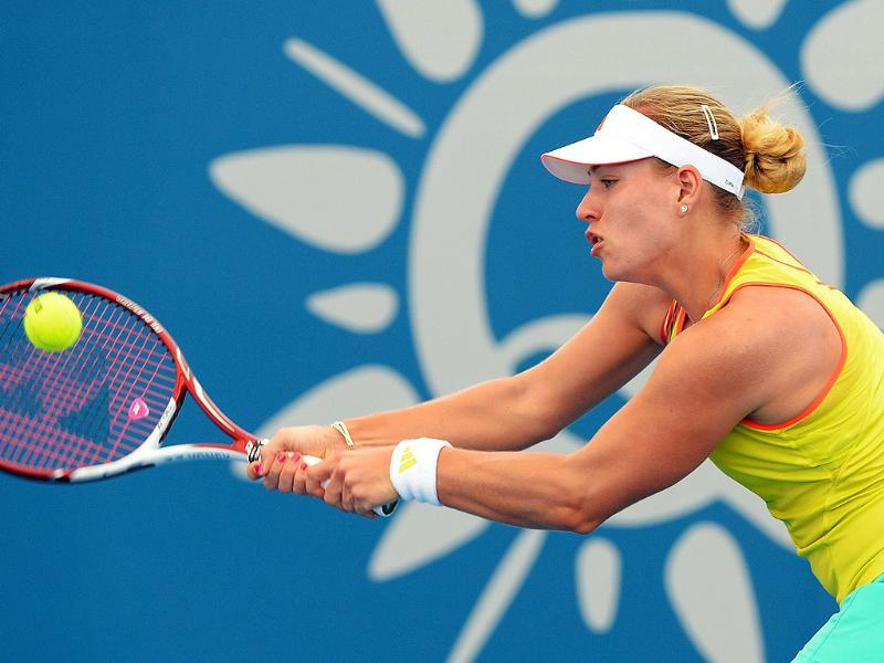 Angelique Kerber of Germany hits a backhand return to Anna Tatishvili of Georgia in the first round at the Brisbane International tennis tournament in Brisbane. AFP/William West