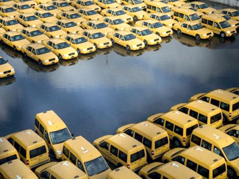 New taxi cabs seen in a lot as flood waters recede in New Jersey. Hurricane Sandy which made landfall along the New Jersey shore, left parts of the state and the surrounding area flooded and without power. AFP/Brendan Smialowski