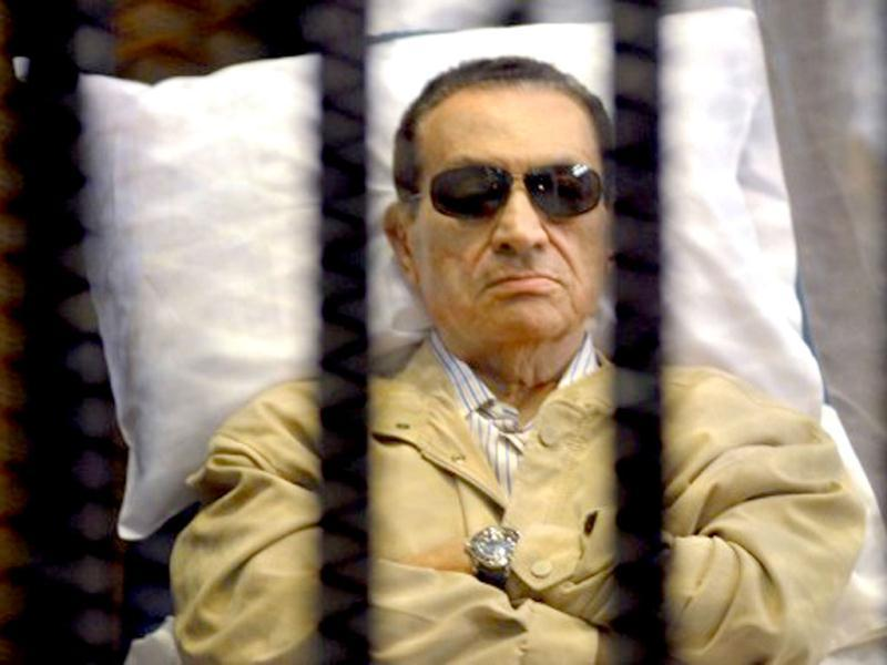 Ousted Egyptian president Hosni Mubarak sits inside a cage in a courtroom during his verdict hearing in Cairo in June. A judge sentenced Mubarak to life in prison after convicting him of involvement in the murder of protesters during the uprising that ousted him in 2011. AFP photo