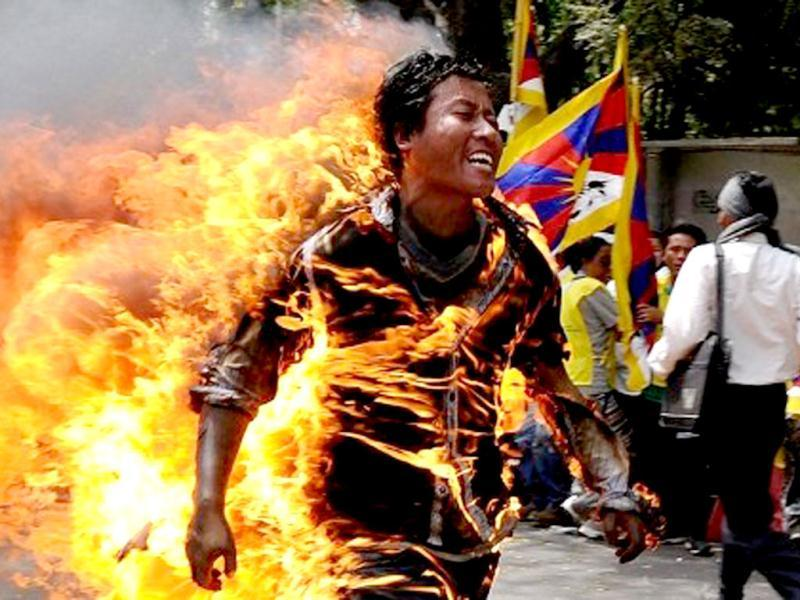 Tibetan exile Jamphel Yeshi, 27, runs as he is engulfed in flames after he set himself on fire to protest against an upcoming visit to India by Chinese President Hu Jintao. AFP photo