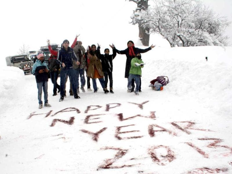 Tourists in snow-bound world-famed Ski resort of Gulmarg celebrating the New Year 2013 at minus 9.6 degree Celsius temperature. (UNI Photo)