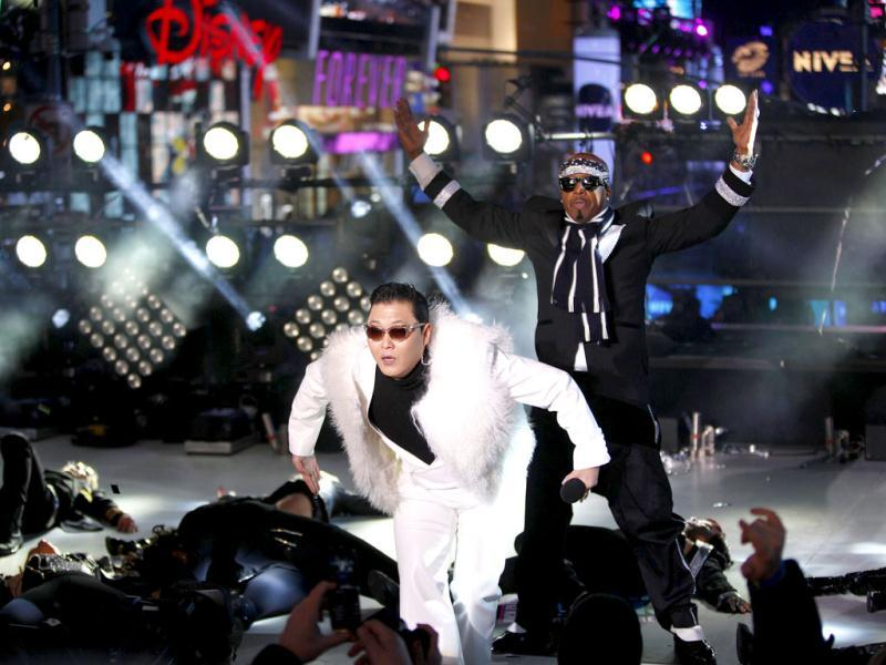 MC Hammer and PSY perform during New Year Eve in Times Square in New York. Reuters/Joshua Lott