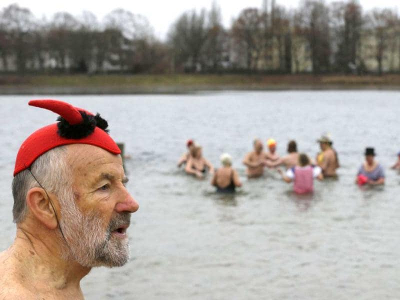 Members of the Berliner Seehunde (Berlin Seals) ice swimmers club take a dip in Lake Orankesee during their traditional New Year swimming event in Berlin. Reuters