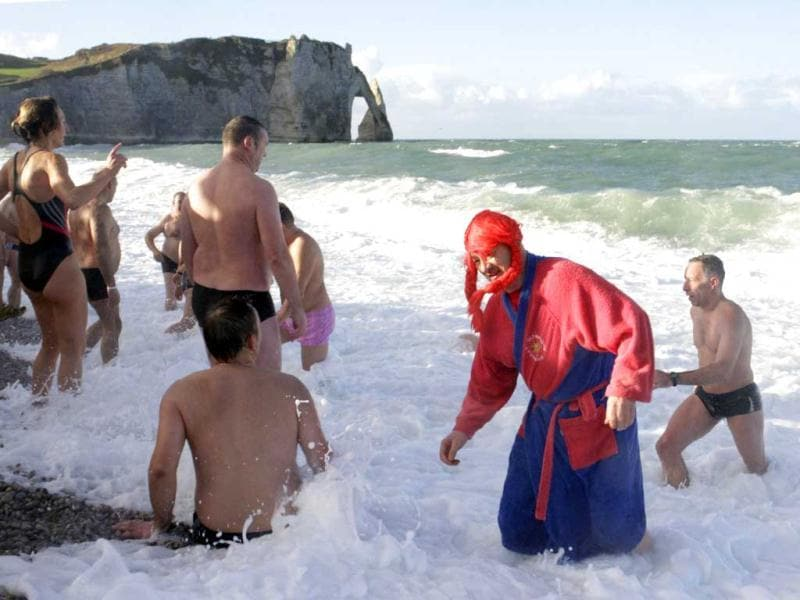 People participate in a traditional New Year's Day swim in front of the famous cliff at Etretat, western France. Reuters