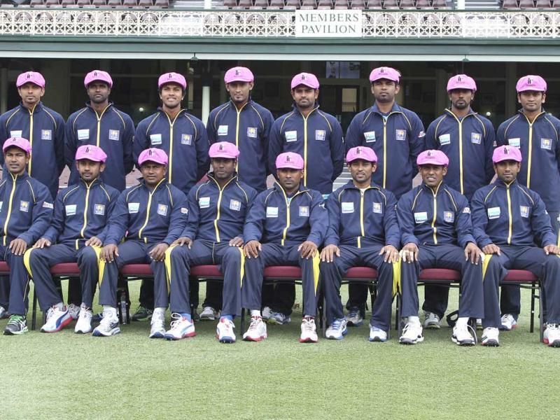 Sri Lanka's cricketers pose for a team photo wearing pink caps before cricket training ahead of the third test cricket matches against Australia in Sydney, Australia. Players donned pink baggy caps in support for the McGrath foundation's breast cancer. AP Photo