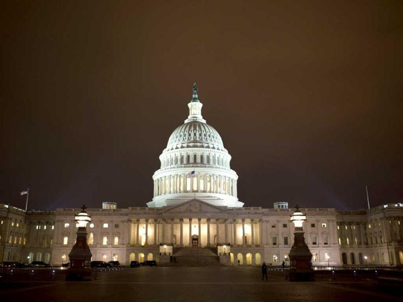 The lights of the US Capitol remain lit into the night as the House continues to work on the