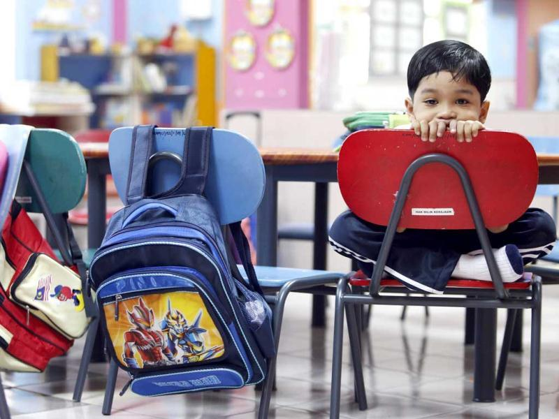 Preschooler Amni Roslan, 6, stays in class as he refuses to join his classmates for outdoor activities during his first day of school in Putrajaya, outside Kuala Lumpur. Reuters Photo