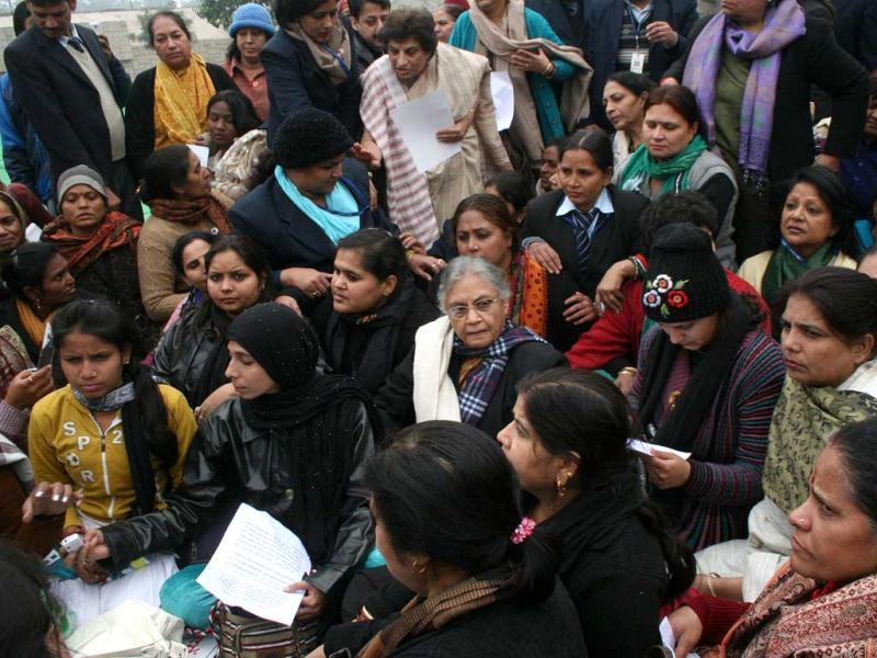 Delhi chief minister Sheila Dikshit sits with participants of a silent rally at Rajghat in New Delhi. UNI