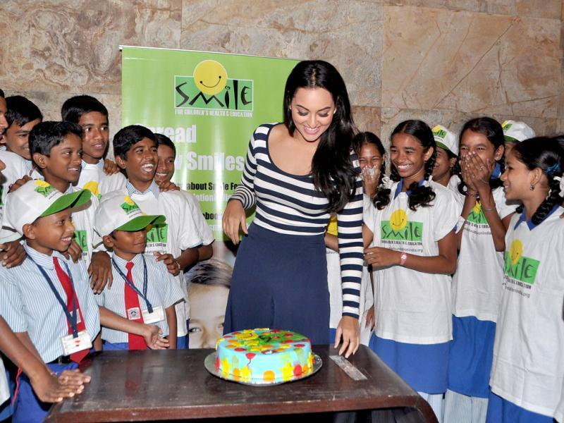 Sonakshi Sinha cut a cake with the kids of the NGO Smile Foundation.
