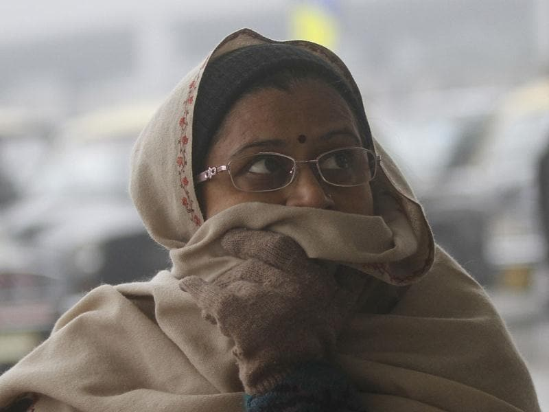 A passenger waits after her flight was delayed due to fog at IGI Airport in New Delhi. HT/Sanjeev Verma