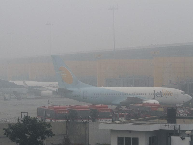 Planes are parked at the IGI Airport on a foggy morning in New Delhi. HT/Sanjeev Verma