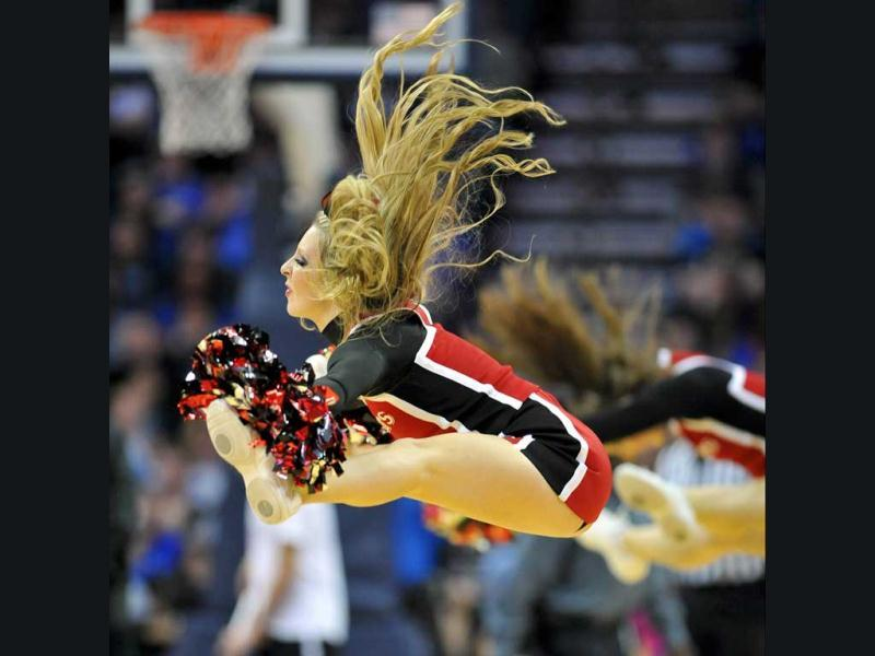 A cheerleader of the Davidson Wildcats performs during a stop in play against the Duke Blue Devils at Time Warner Cable Arena in Charlotte, North Carolina. AFP Photo