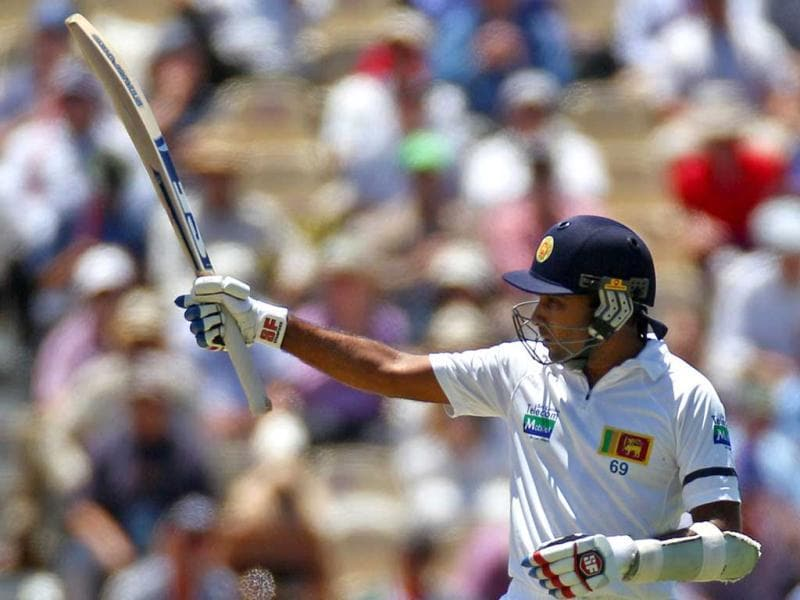 Sri Lanka's Mahela Jayawardene raises his bat after making 50 runs against Australia on the first day of their cricket test match in Sydney, Australia. AP Photo