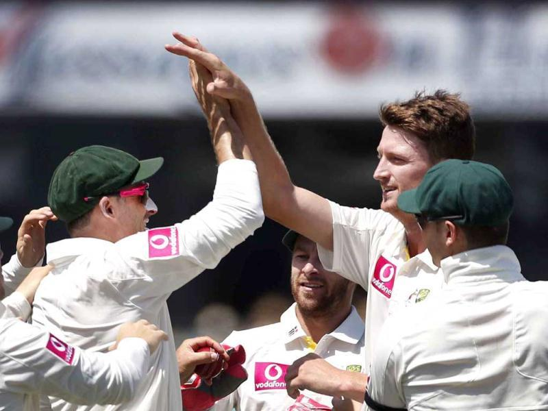 Australia's Jackson Bird (R) congratulates teammate Mike Hussey (L) after they combined to dismiss Sri Lanka's Dimuth Karunaratne during the first day's play of the third cricket test match at the Sydney Cricket Ground. Reuters Photo