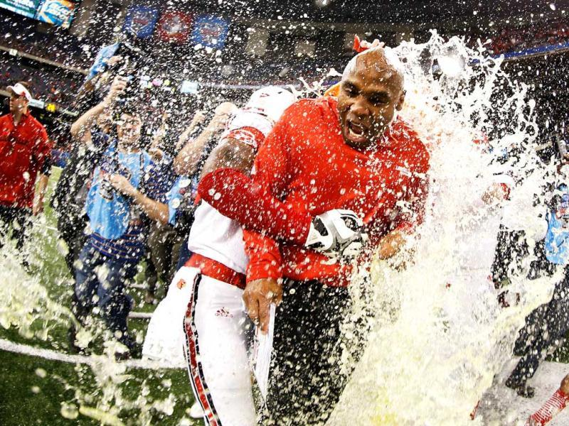 The Gatorade bucket is dumped on head coach Charlie Strong of the Louisville Cardinals after their 33 to 23 win over the Florida Gators in the Allstate Sugar Bowl at Mercedes-Benz Superdome in New Orleans, Louisiana. AFP Photo