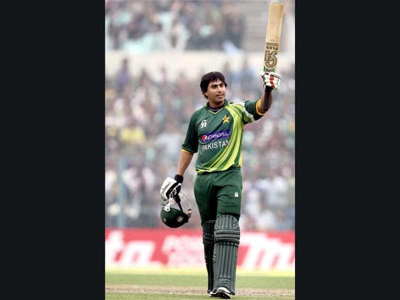 Pakistan's N Jamshed celebrates his century during the second ODI cricket match against India at Eden Garden in Kolkata. PTI/Ashok Bhaumik