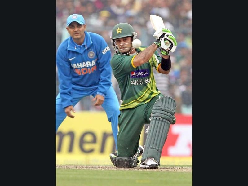 Pakistan's M Hafeez in action during the second ODI cricket match against India at Eden Garden in Kolkata . PTI/Ashok Bhaumik