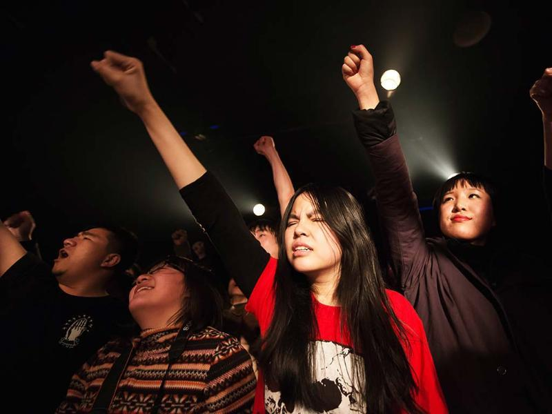 Fans during a performance by punk band Demerit at the Mao Livehouse music venue in Beijing. Traditionally outcast by state radio and television, independent music acts in Beijing continue to pack out the city's many 'livehouse' venues. AFP/Ed Jones