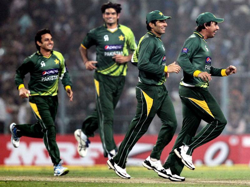 Pakistani players celebrate the fall of a wicket during the second ODI cricket match against India at Eden Garden in Kolkata. PTI/Ashok Bhaumik