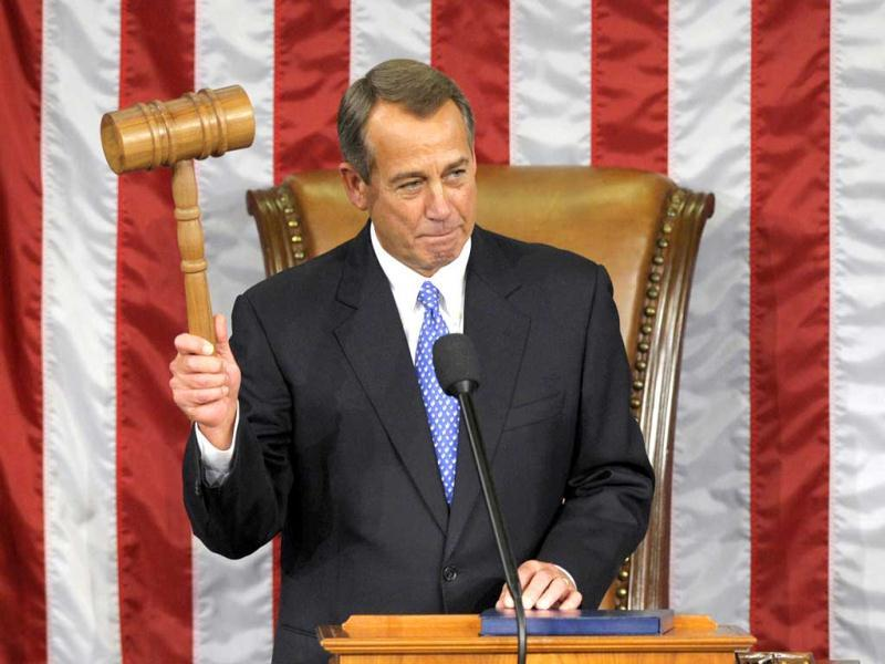 House Speaker John Boehner of Ohio holds up a gavel in the House chamber on Capitol Hill in Washington after being re-elected House Speaker as the 113th Congress began. AP Photo
