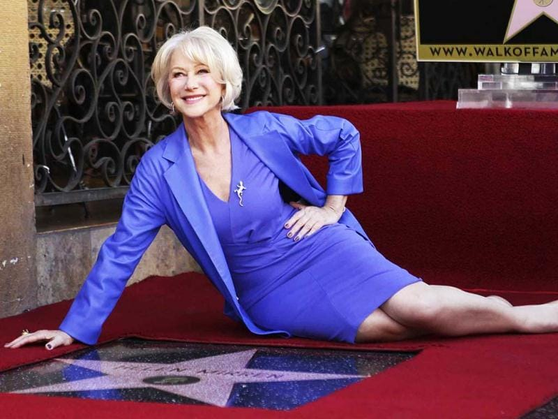 Helen Mirren poses with her newly-unveiled star, the 2,488th star on the Hollywood Walk of Fame, in Hollywood, California. Reuters