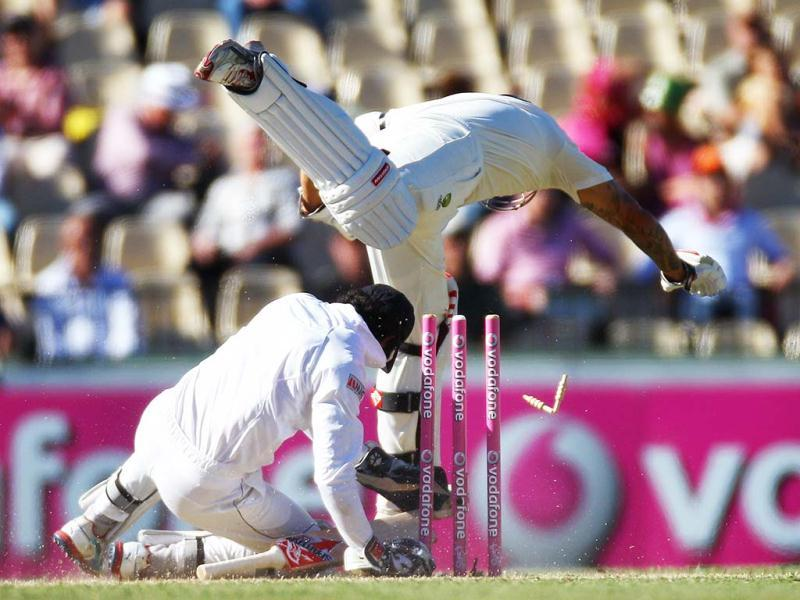 Australia's Mitchell Johnson (top) collides with Sri Lanka's wicket keeper Dinesh Chandimal on the second day of their cricket test match in Sydney, Australia. Sri Lanka made 294 all out in their first innings. AP Photo