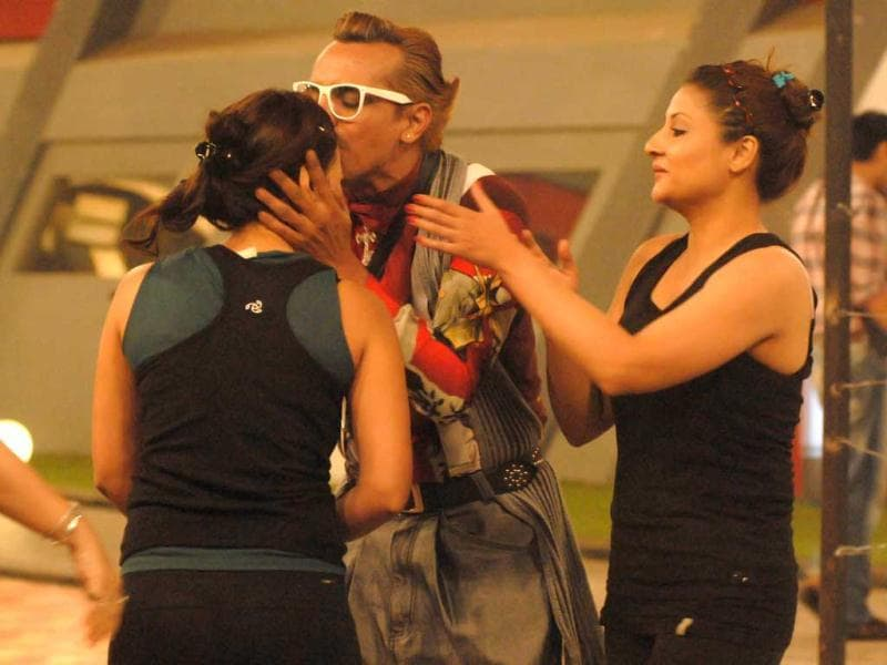 Imam Siddique in a cordial mood in Bigg Boss 6 house. Here he is seen kissing Sana Khan on her forehead, blessing her as Urvashi Dholakia watches.