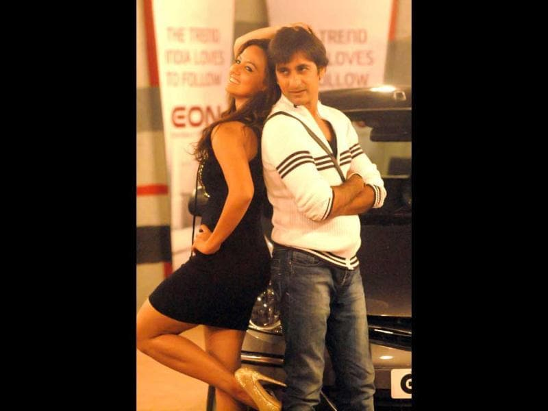 Sana Khan and Rajev Paul pose for a calender shoot during a task in Bigg Boss 6 house.