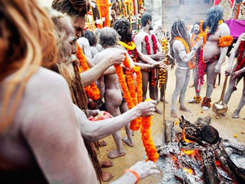 Naga Sadhus, or Naked holy men, participate in a religious procession towards the Sangam. Millions of pilgrims are expected to take part in the large religious congregation on the banks of the Sangam during the festival in January 2013, which falls every 12th year. (AP Photo)