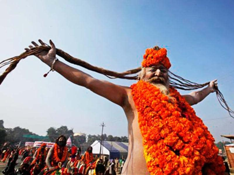 A Naga Sadhu, who has come to participate in Mahakhumbh poses as he shows his long hair during a procession. Millions of pilgrims are expected to take part in the large religious congregation on the banks of Sangam, the confluence of rivers Ganges, Yamuna and mythical Saraswati during the Mahakumbh Mela starting from January 14. (AP Photo)