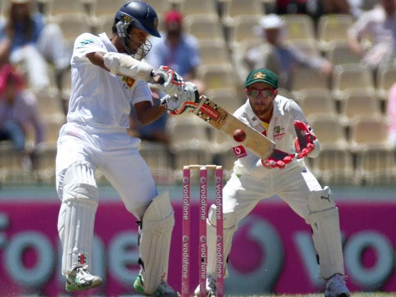 Sri Lanka's Dimuth Karunaratne cuts a ball against Australia on the third day of their cricket test match in Sydney, Australia. Australia are declared 432 for 9 in reply to Sri Lanka's 294 all out in their first innings. AP Photo