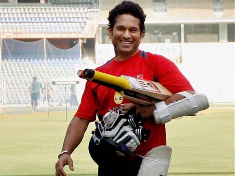 Sachin Tendulkar carries his bat and gloves during a practice session at the Wankhede Stadium in Mumbai. PTI/Santosh Hirlekar