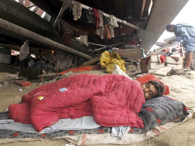 A homeless person sleeps under the old Yamuna Bridge in New Delhi. HT/Ajay Aggarwal