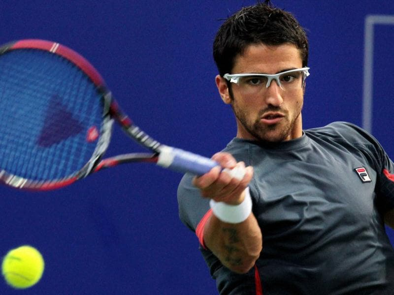 Janko Tipsarevic of Serbia in action against Slovenian Aljaz Beden in their semifinal match at the ATP Chennai Open 2013 in Chennai. PTI/R Senthil Kumar