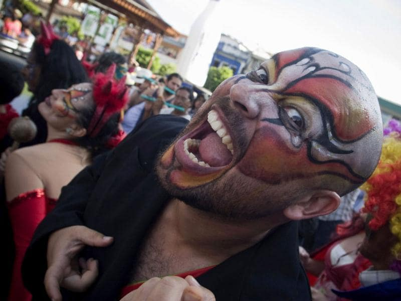 A man with his face painted gestures as he takes part in the Devil's Carnival in Riosucio, Caldas department, Colombia. AFP Photo