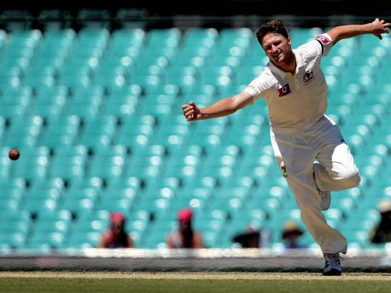 Australian fastbowler Jackson Bird tries to stop a shot off his bowling on the fourth day of the third cricket Test match between Australia and Sri Lanka at the Sydney Cricket Ground. AFP Photo