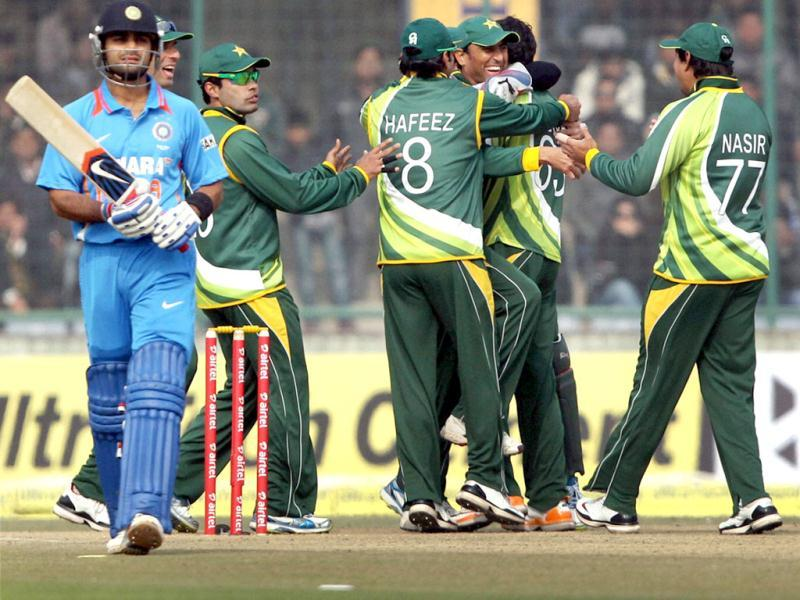 Pakistan's Junaid Khan celebrates with his teammates after taking wicket of Virat Kohali (L) during the last ODI match at Ferozeshah Kotla in New Delhi . PTI Photo