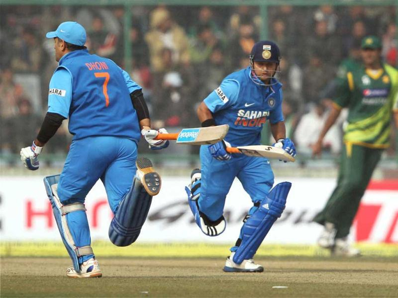MS Dhoni and Suresh Raina running between wicket during the last ODI match against Pakistan at Feroz Shah Kotla Stadium in New Delhi . PTI Photo