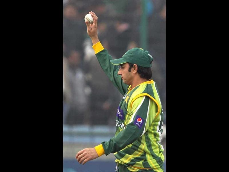 Pakistan's Saeed Ajmal acknowledges the crowd after taking five wickets during the last ODI match at Feroz Shah Kotla Stadium against India in New Delhi . PTI Photo